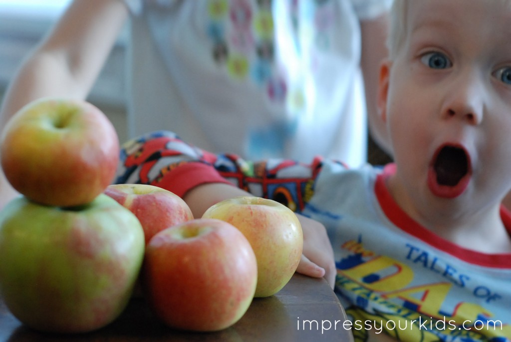 Make an Apple Print Lunch Bag for your Sponsored Kids from impressyourkids.com